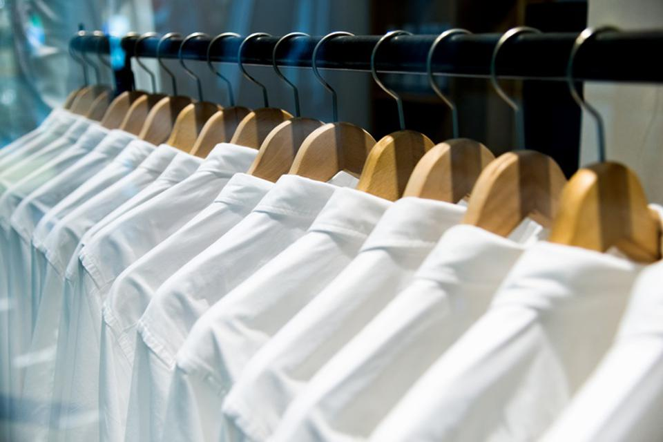 Group of white shirts hanging on hangers