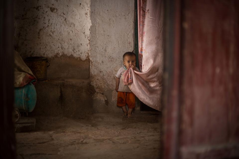 A Uyghur boy is pictured on the street of the Kashgar old...