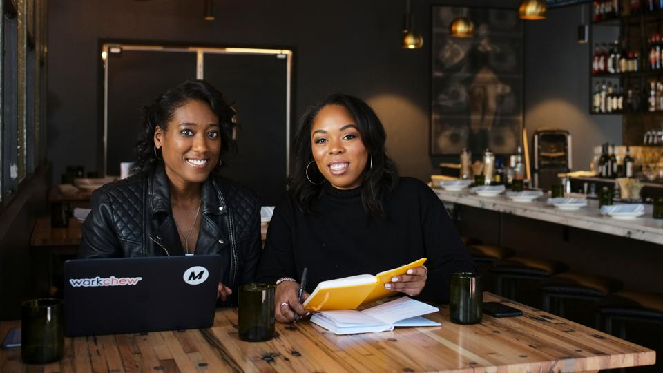 WorkChew Co-Founders Maisha Burt (left) and Allyson McDougal (right) working at a restaurant