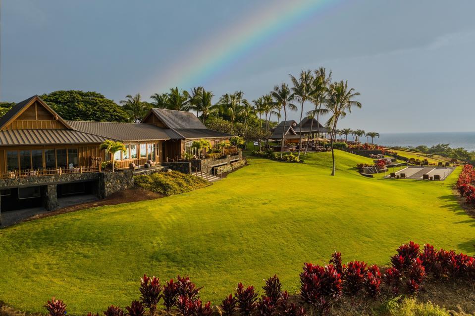 rainbow over clubhouse at hokulia residential club enlave hawaii big island kona kailua