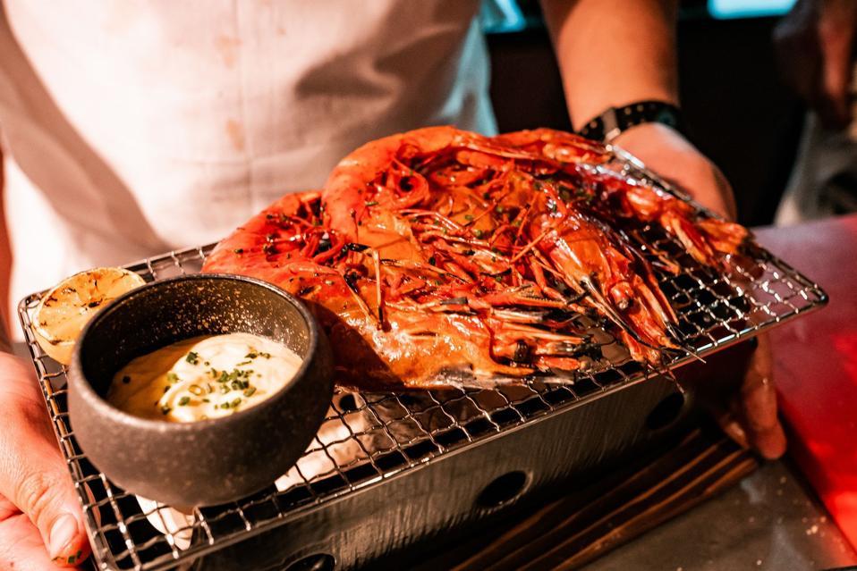 Closeup of grilled giant shrimp at Salvaje restaurant Barcelona.