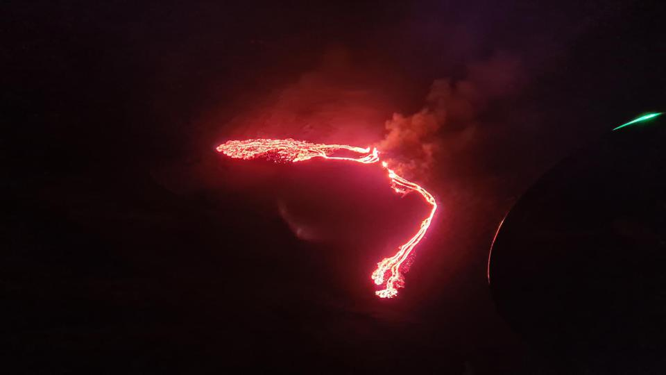 A coast guard photo shows the first image of the volcanic eruption on Iceland's Reykjanes Peninsula.