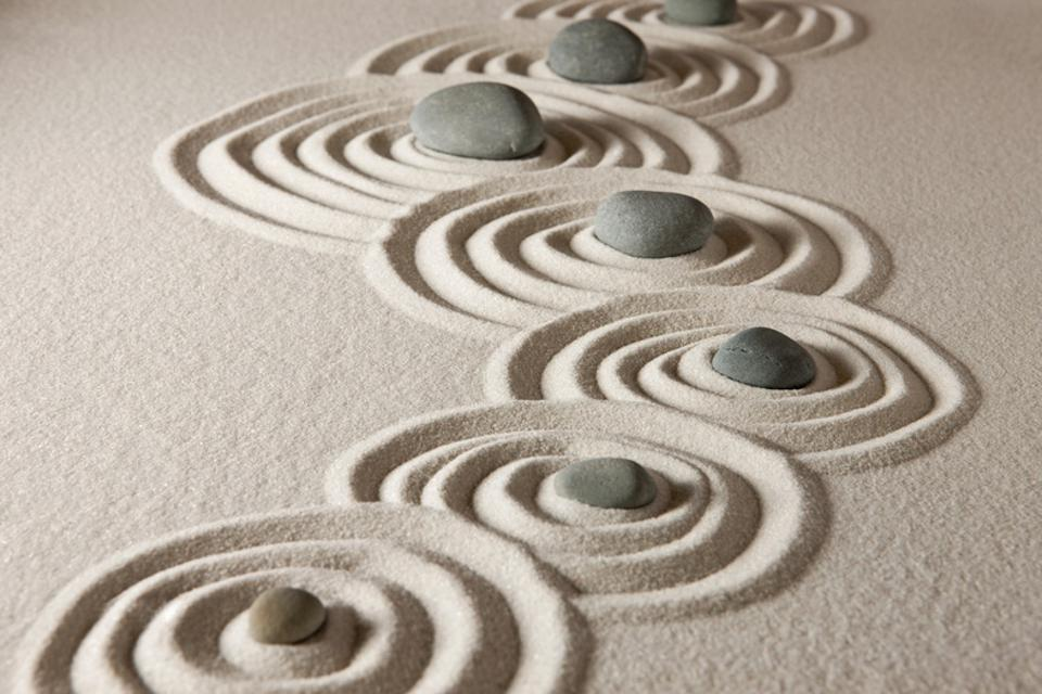 Zen stones showing importance of shifting approaches to wellbeing