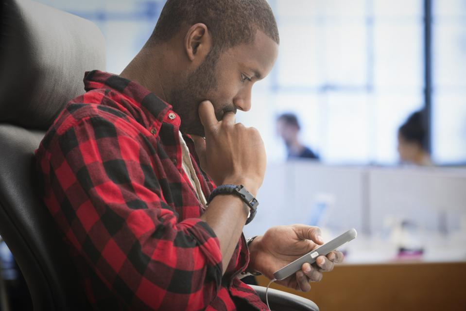 Black man using cell phone