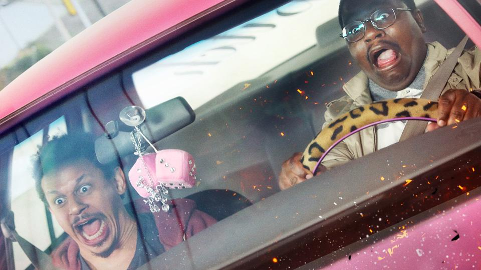 Chris and Bud scream in their pink car