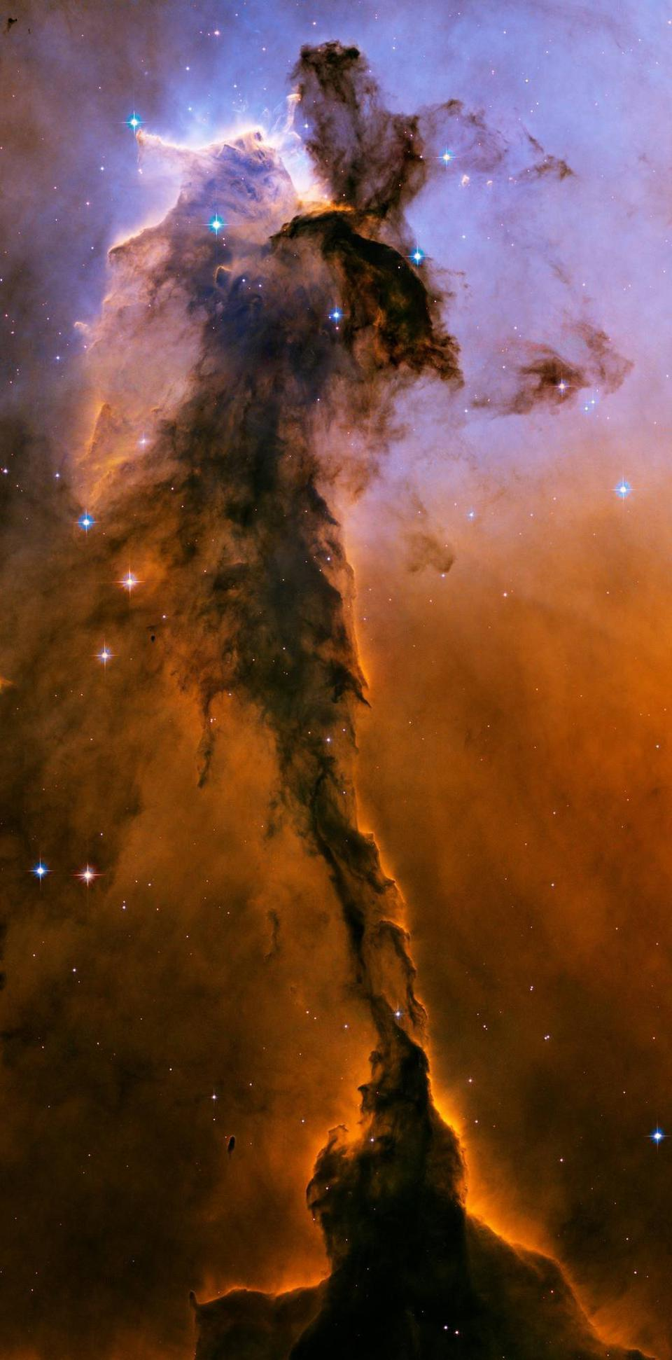 This 9.5 light-year long spire of dust, known as the Fairy, is found in the Eagle Nebula.