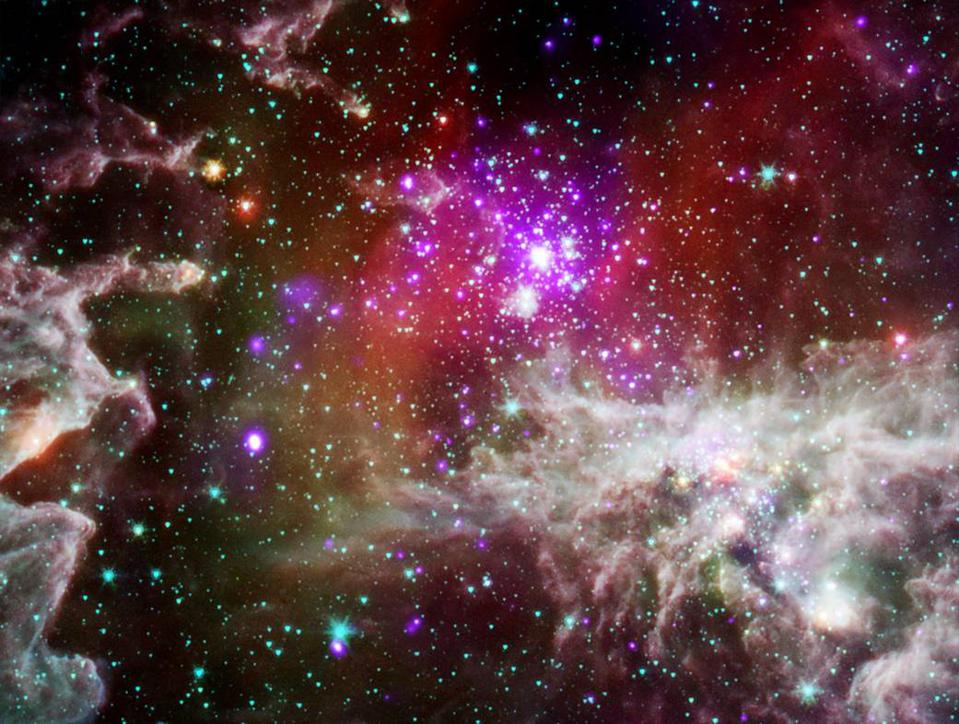This composite image of NGC 281 contains X-rays from Chandra (purple) and IR Spitzer data.