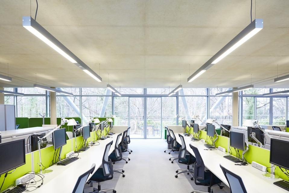 Modern open plan office with hot desks.