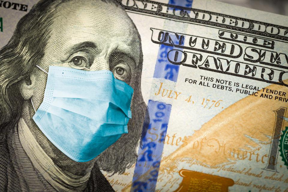 Benjamin Franklin With Worried and Concerned Expression Wearing Medical Face Mask On One Hundred Dollar Bill