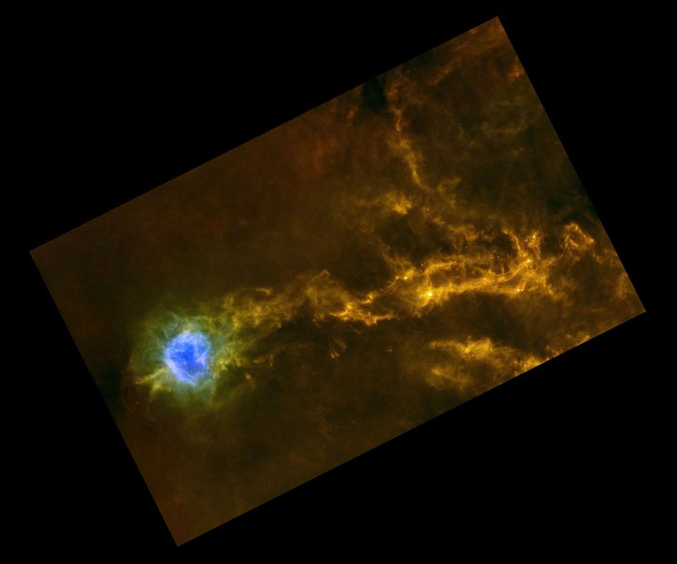 This view of the Cocoon Nebula, IC 5146, shows a star-forming region from ESA's Herschel.