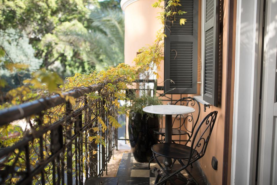 A small table sits on the terrace of the Montefiore hotel in Tel Aviv, Israel