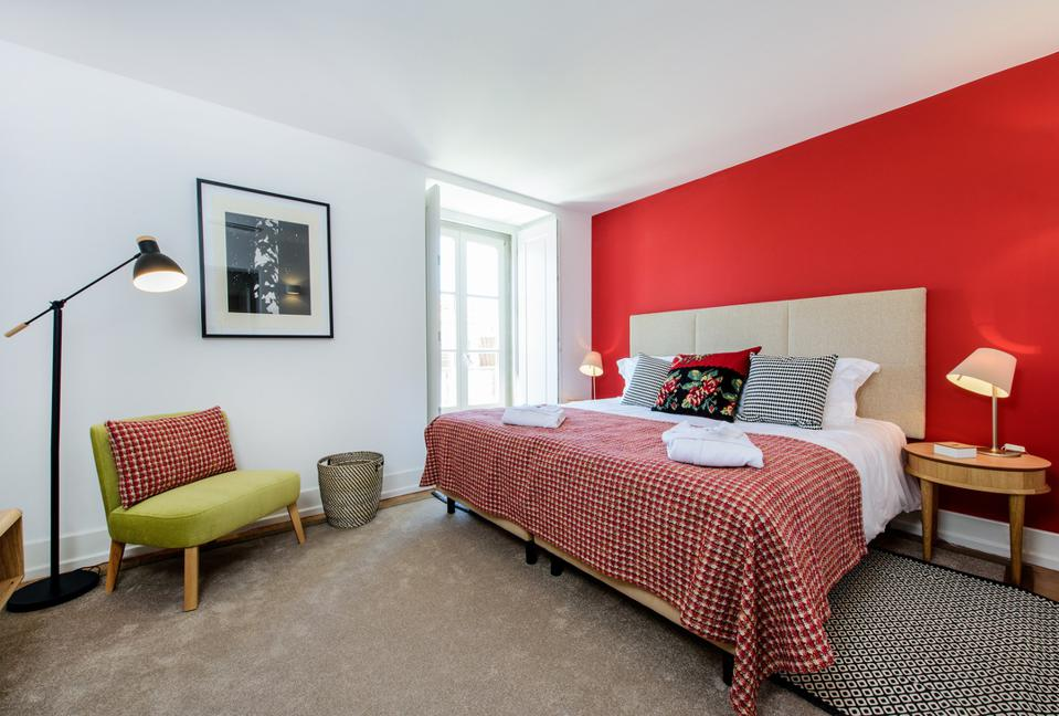 A wall of the Martinhal Chiado hotel in Lisbon, Portugal, is painted bright red