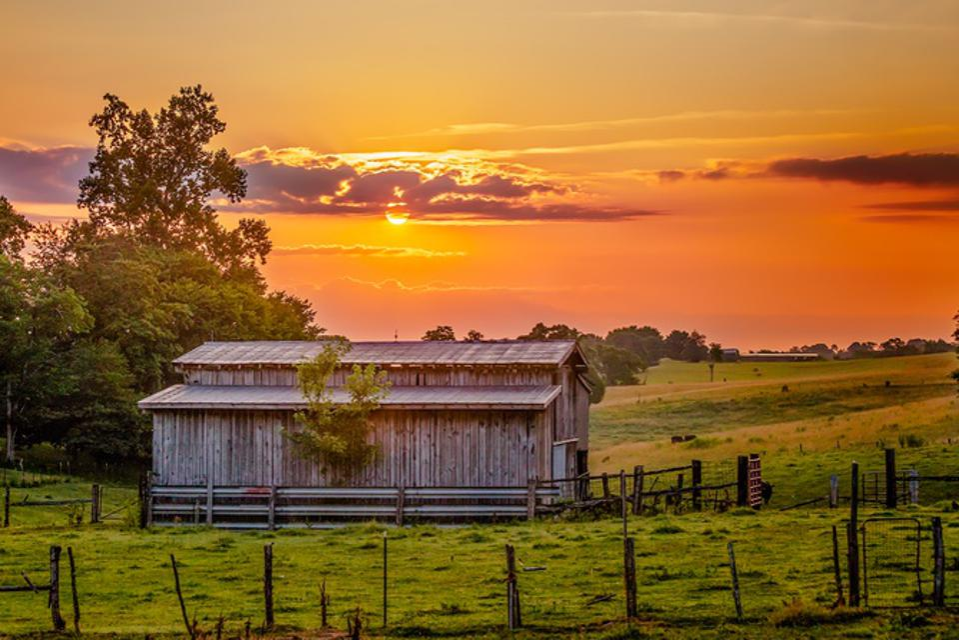 Barn with Orange Sunrise Sky