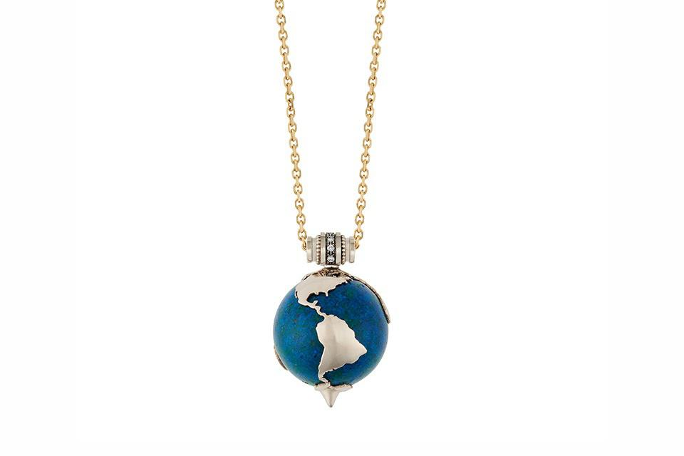 The Mother Earth pendant features a gold outline of the continents atop a round opal
