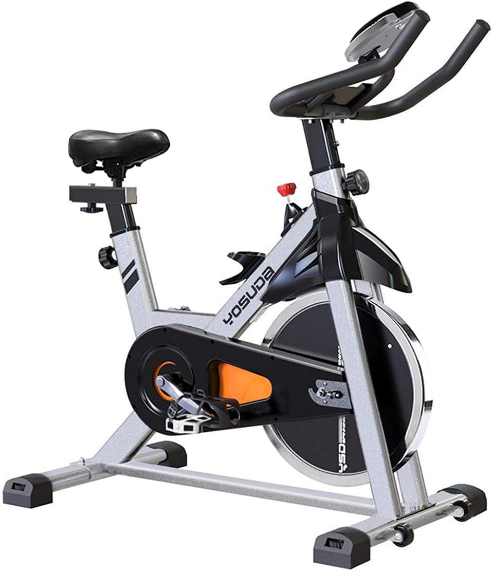A photo of the YOSUDA Indoor Cycling Bike with iPad Mount against a white background