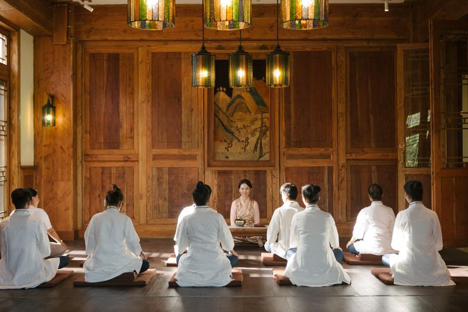 Hotel guests meditating at Songtsam Hotels