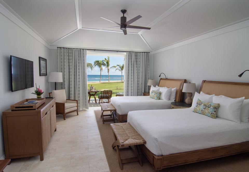 View of two Queen beds facing beach at Prestigious Ocean Room at Half Moon, Montego Bay