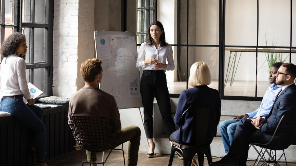 Woman leads an employee training class.