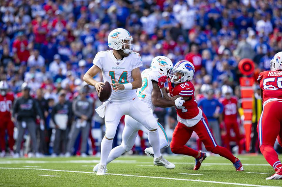 ORCHARD PARK, NY - OCTOBER 20:  Ryan Fitzpatrick #14 of the Miami Dolphins drops back to pass during the first quarter against the Buffalo Bills at New Era Field on October 20, 2019 in Orchard Park, New York. Buffalo defeats Miami 31-21.  (Photo by Brett Carlsen/Getty Images)