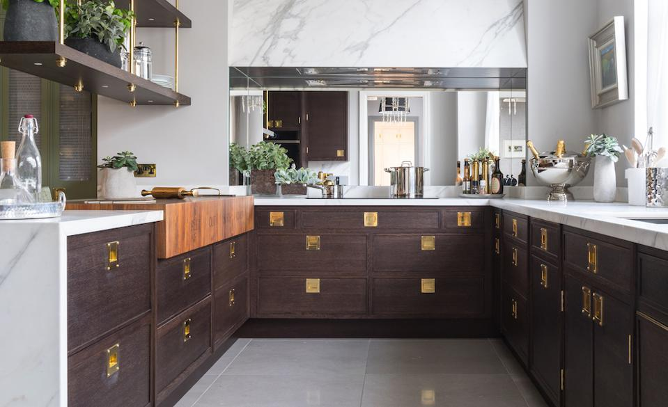 A kitchen with wood and marble finishes