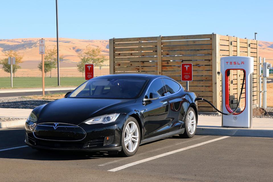 Tesla electric car at charging station