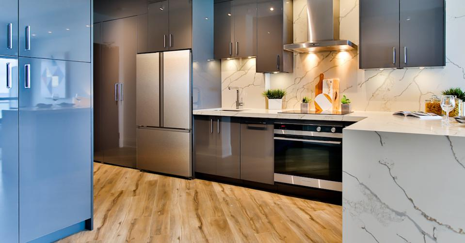 A kitchen with stainless steel appliances and marble