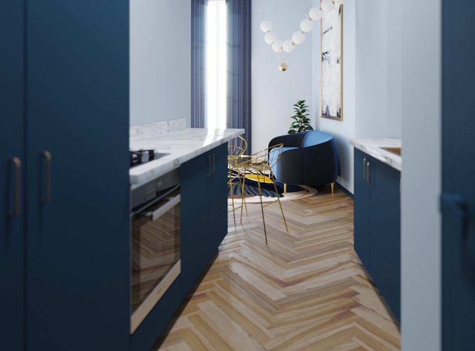 A blue kitchen and living room with wood floors throughout.