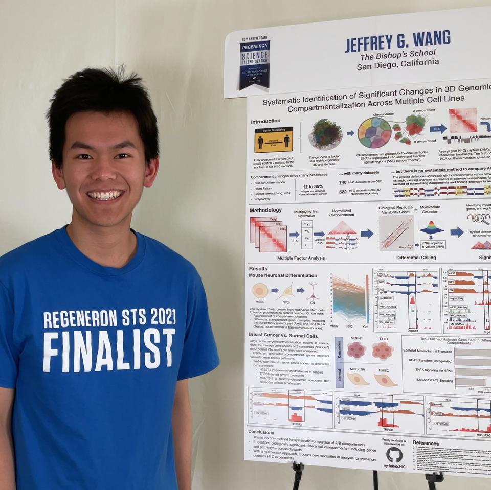 Jeffrey Wang stands in front of his project display board