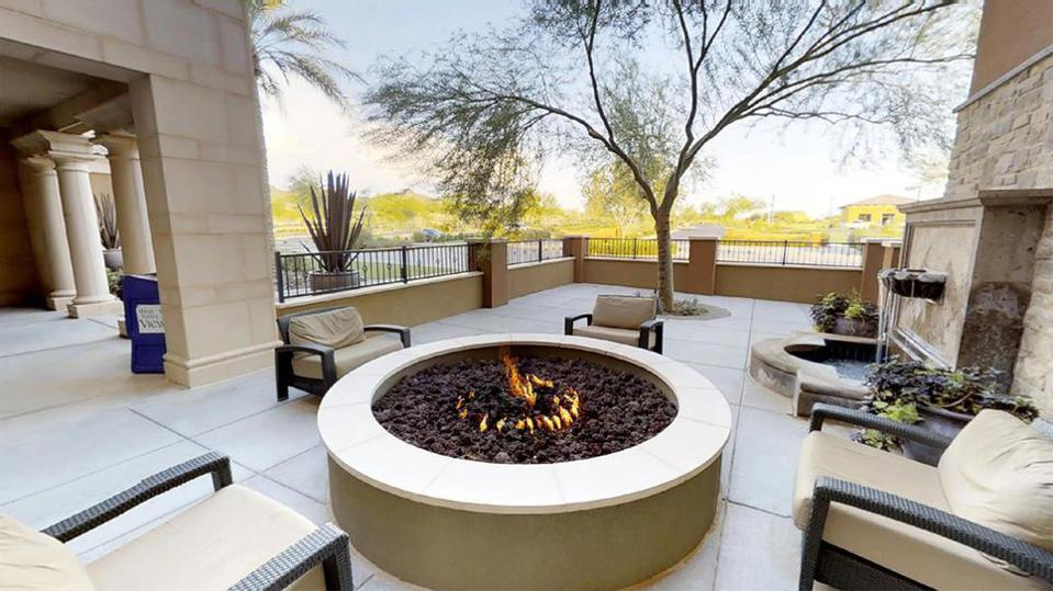Outdoor seating area with fire table and water fountain