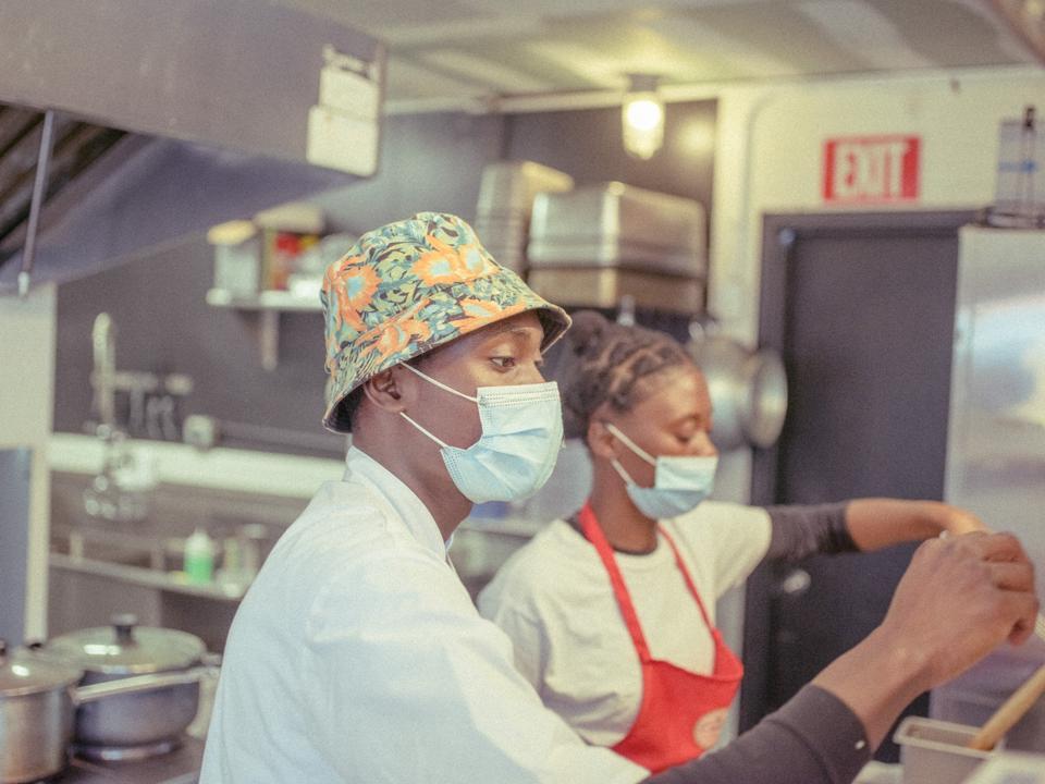 Restaurant owners handling orders
