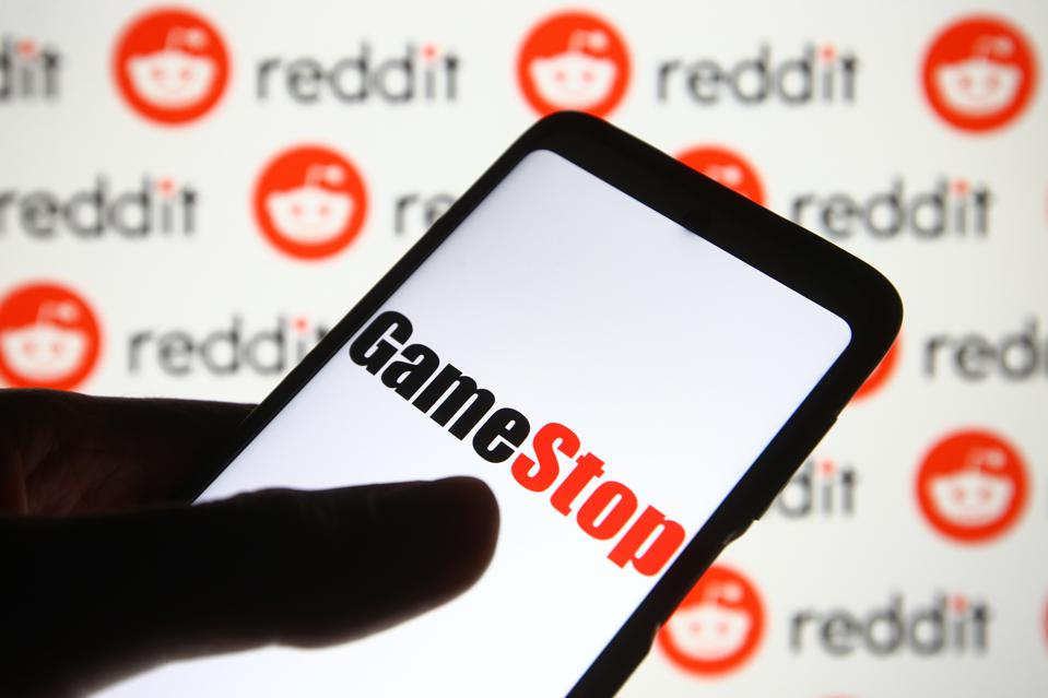 In this photo illustration a GameStop logo is seen on a...