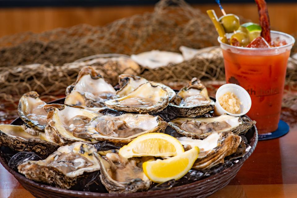 Fresh Gulf oysters along with a signature Bloody Mary is a favorite combo at Anna Maria Oyster Bar.