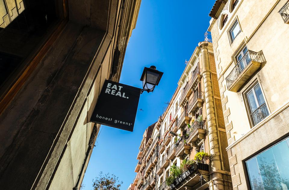 closeup of a Honest Greens restaurant sign in Barcelona.
