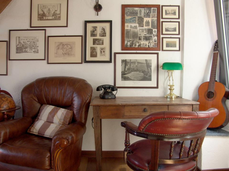 One of the public areas at the OmHom hotel in Italy is decorated with memorabilia.