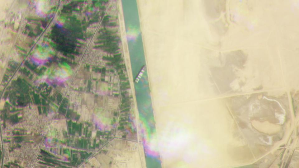 An aerial image shows the Ever Given blocking the Suez Canal.