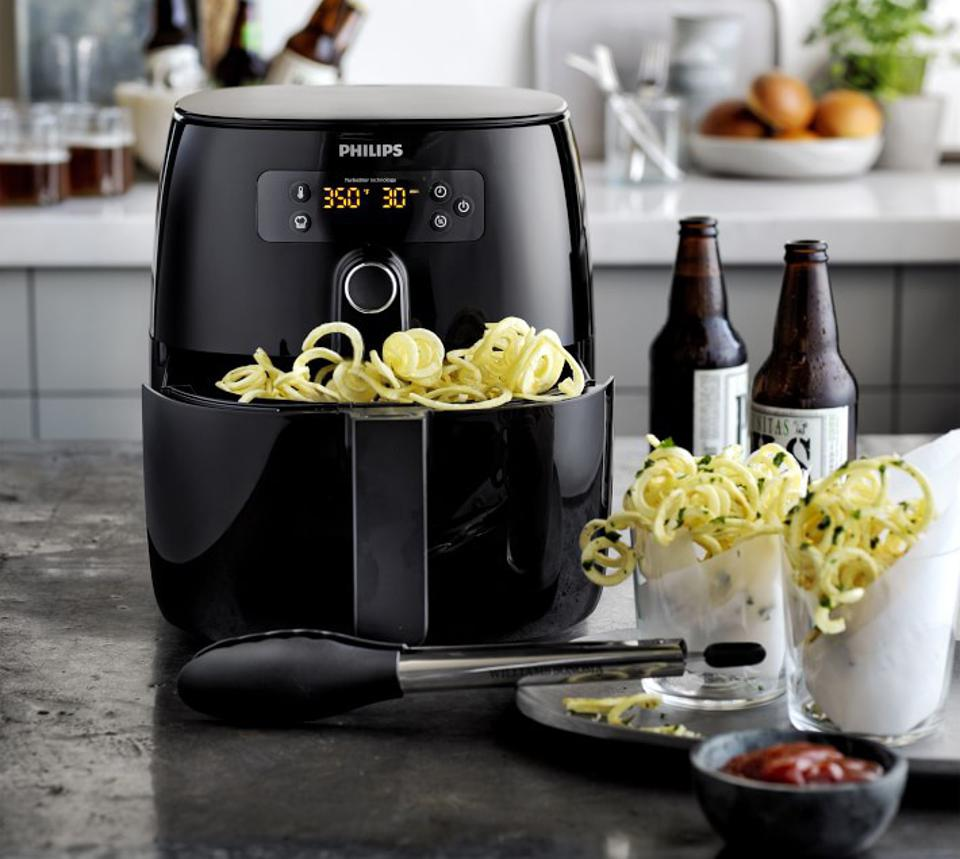 A front-facing shot of the Philips Avance Air Fryer next to spiralized zucchini