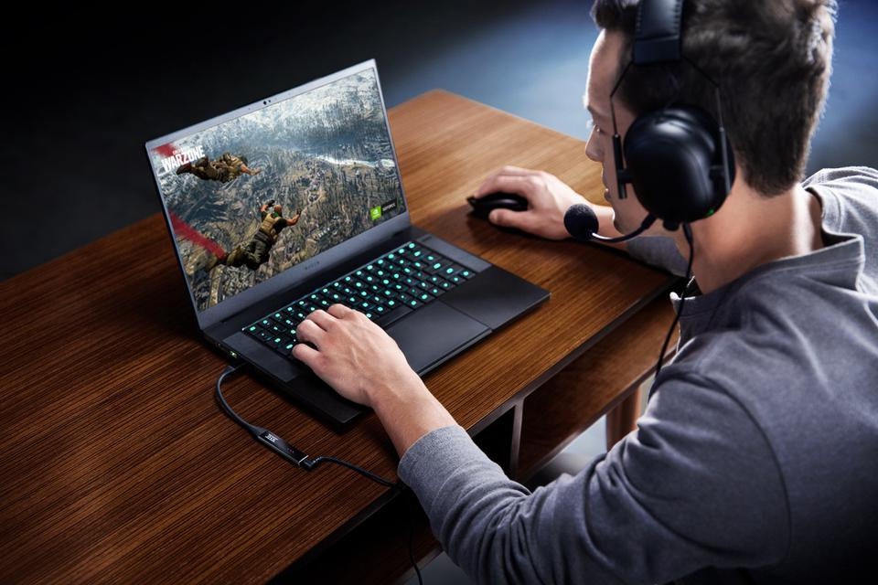 Man at desk with laptop and THX Onyx DAC/Amp