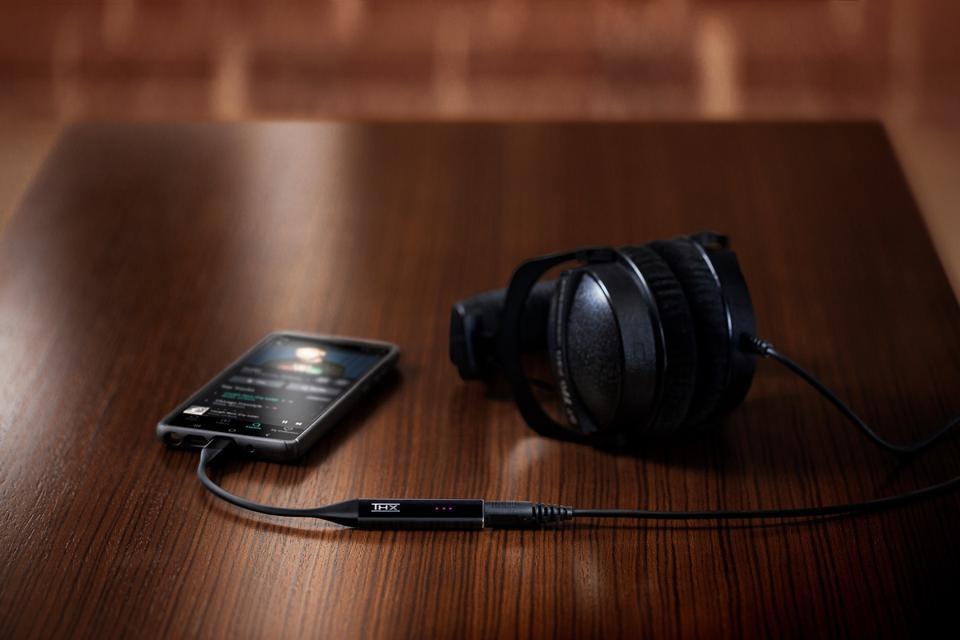 Smartphone and THX Onyx with headphones
