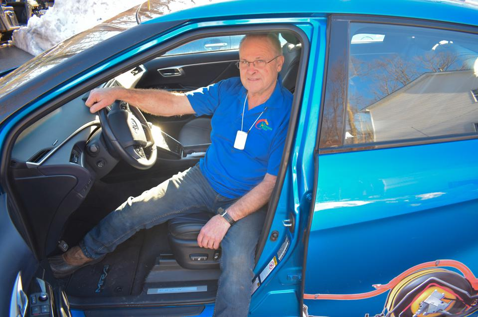 Hydrogen-fueled cars will become prevalent by 2030, says Mike Strizki, who is sitting.