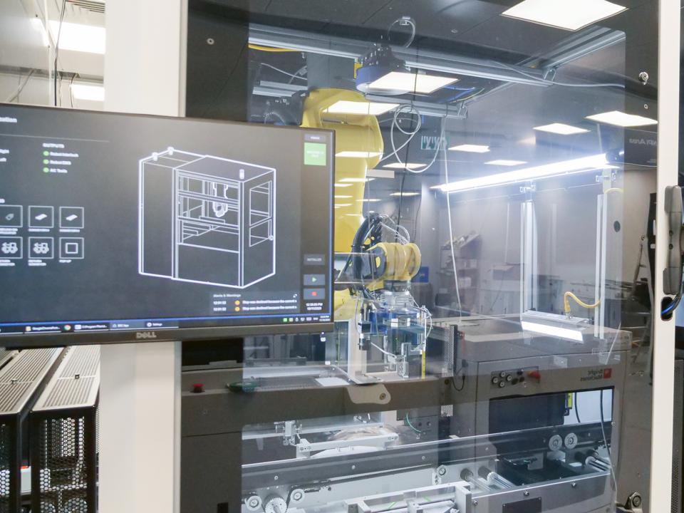 A robotic cell assembling a product.