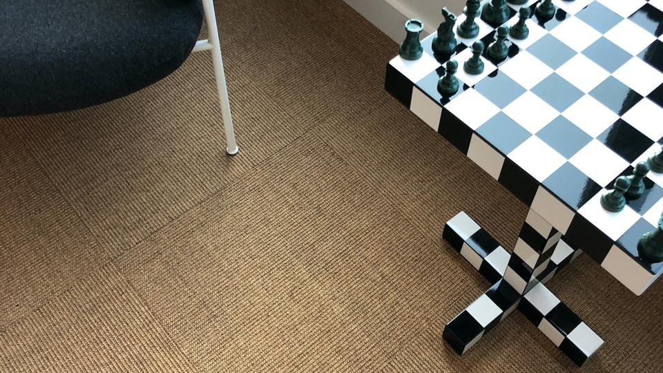 These are sisal carpet tiles installed in a quarter turn pattern in color 'sahara'