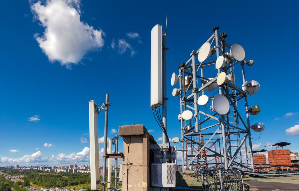 Telecommunication tower with wireless communications systems are including microwave and panel antennas.