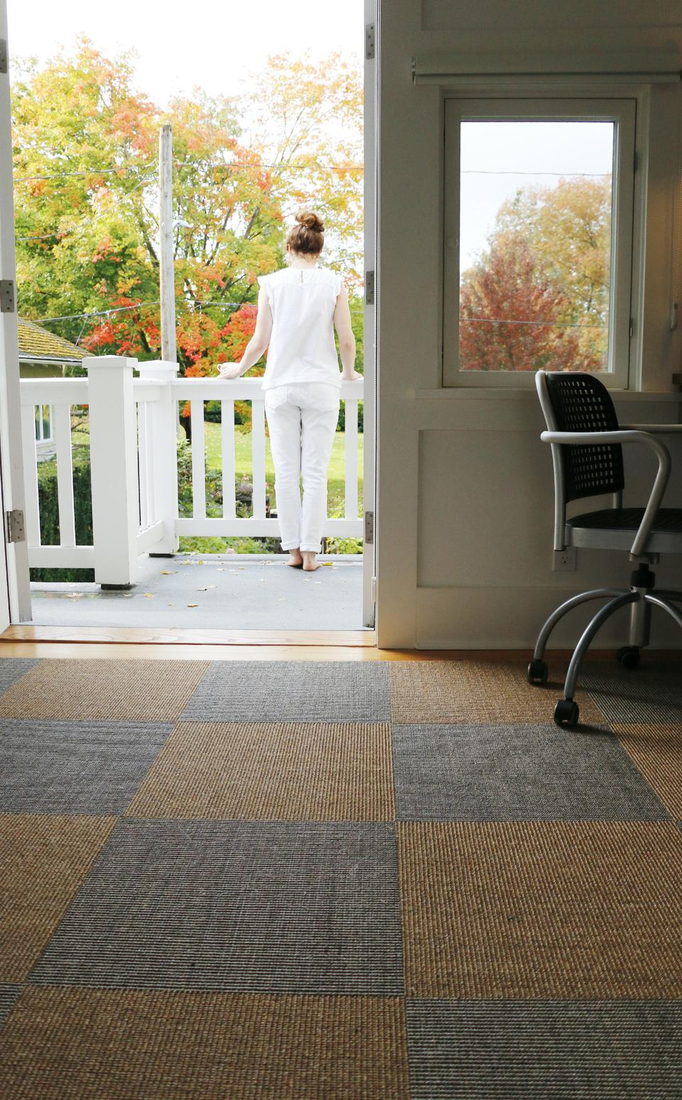 These are Sisal Carpet Tiles in alternating colors functioning as a large rug.