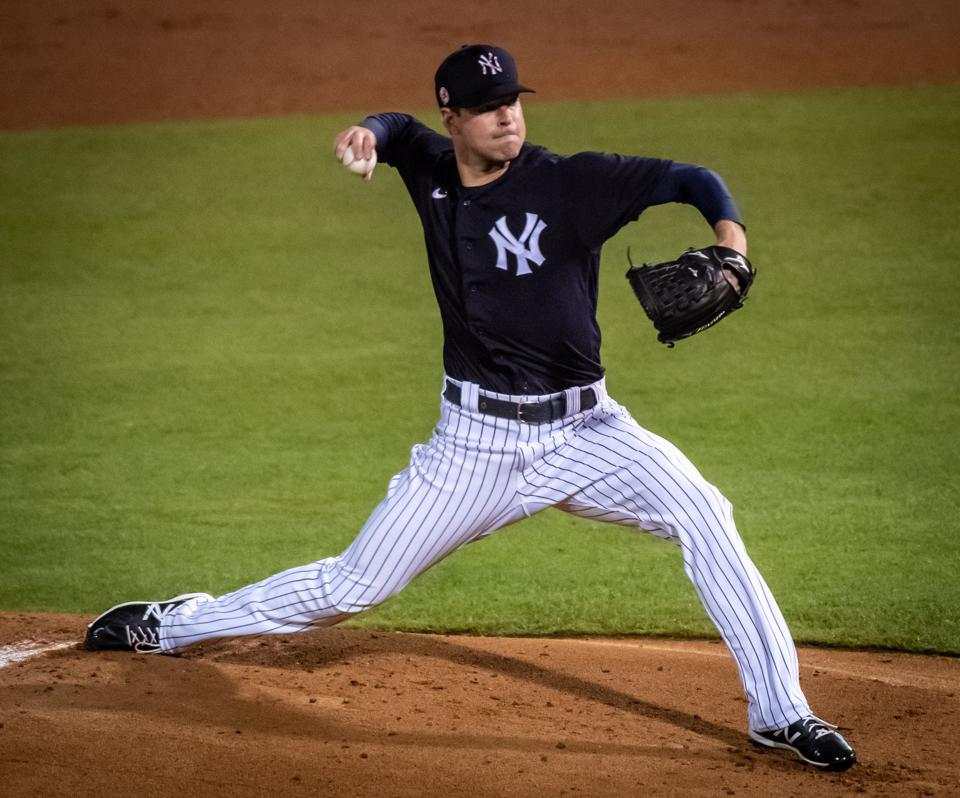 New York Yankees pitcher Corey Kluber throws against the Toronto Blue Jays in spring training game
