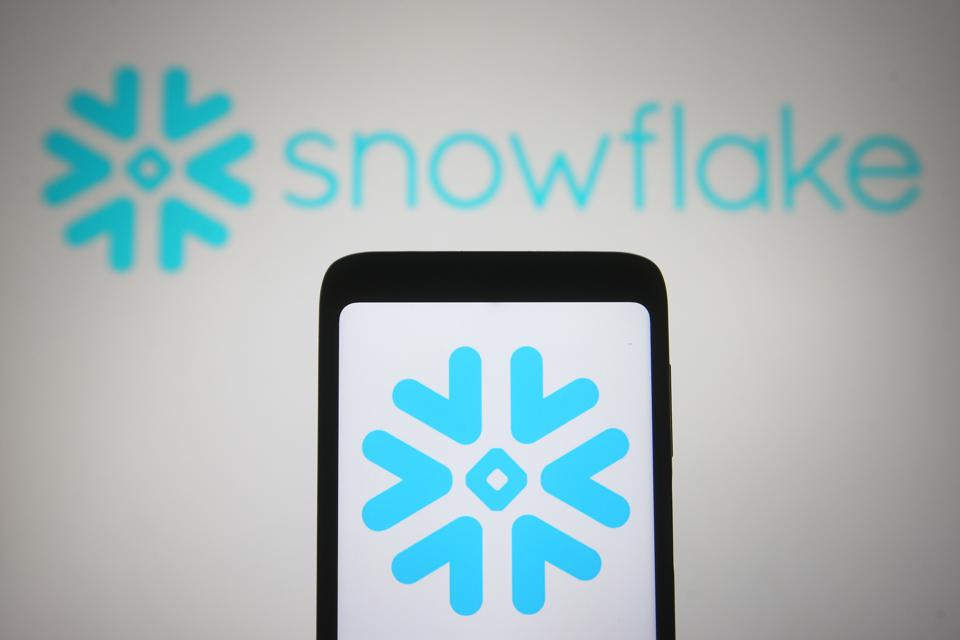 In this photo illustration the Snowflake Inc. logo of a US...