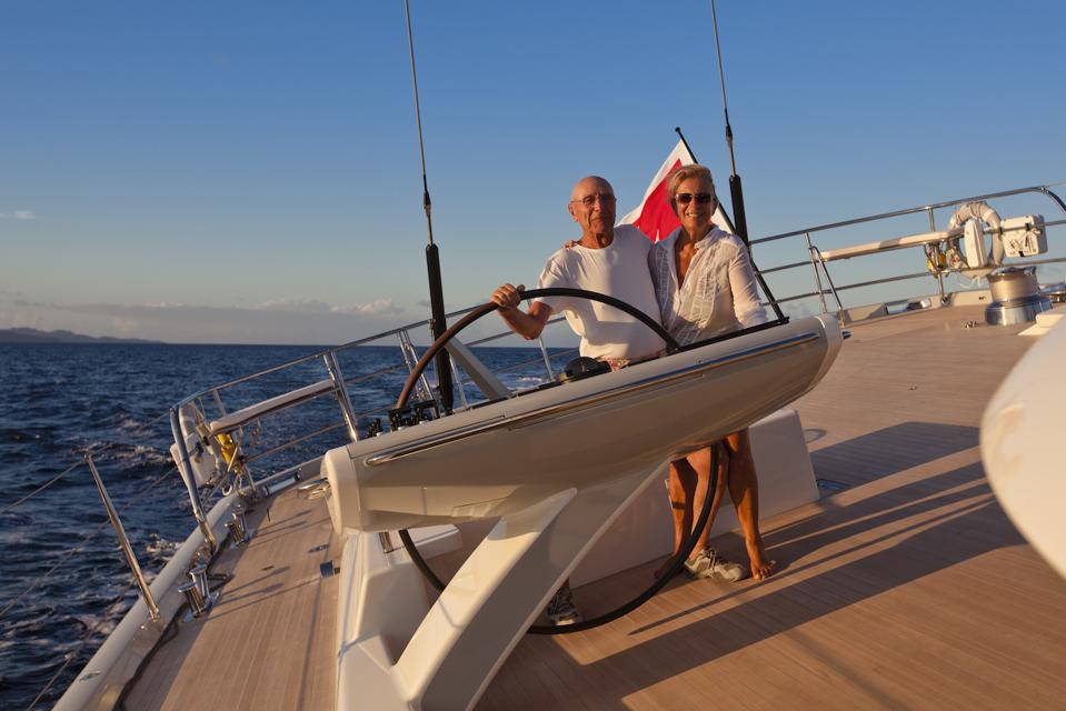 Paola and Salvatore Trifirò at the helm of their 108-foot-long sailing yacht Ribelle.