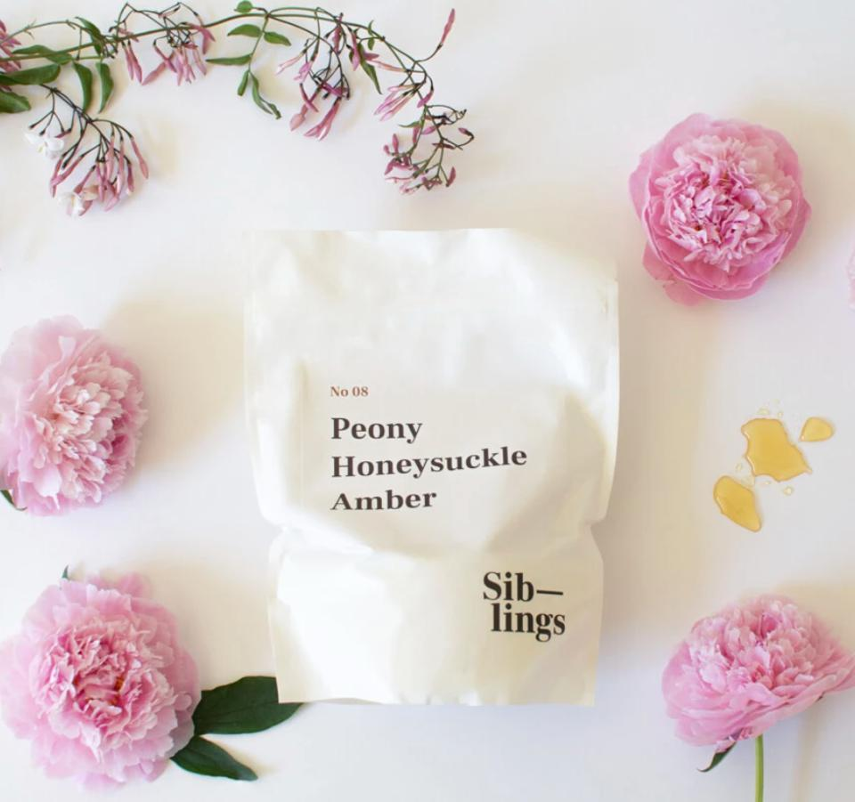 a bag of wax with pink peonies