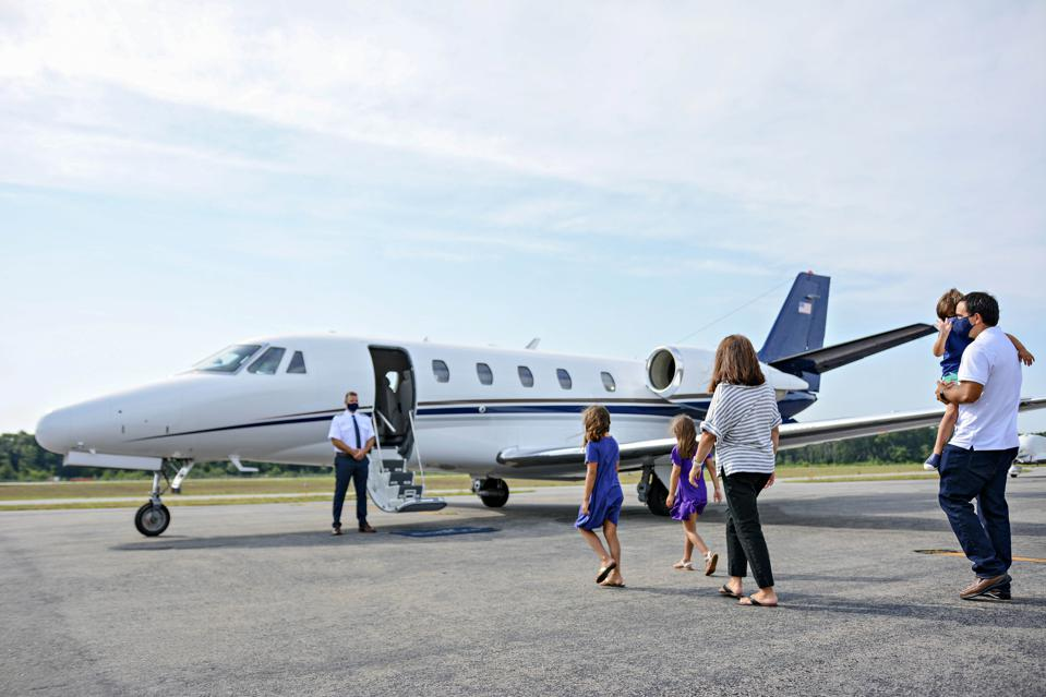 Family boarding a Sentient private jet.