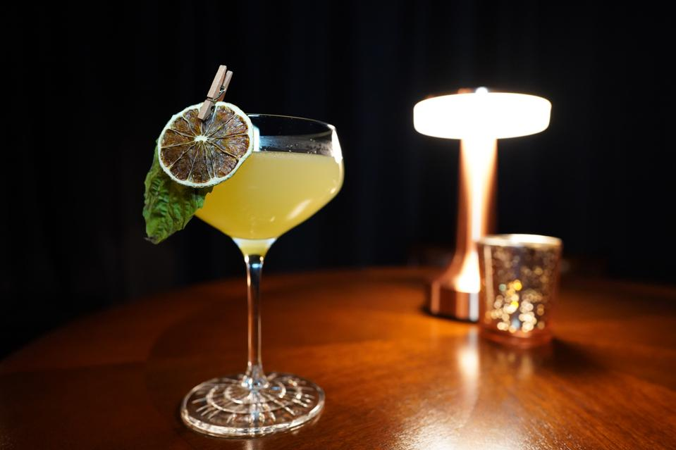 a cocktail on a dimly lit table