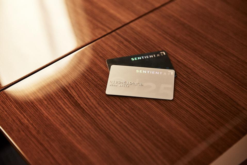 Private jet credit cards on a desktop.